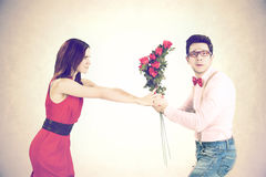 Angry woman refuses roses for Valentine`s Day Stock Images