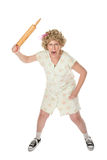Angry woman with rolling pin Stock Photography