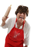 Angry woman with rolling pin stock image