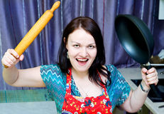 Angry woman with rolling pin and pan Stock Photo