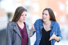 Free Angry Woman Scolding Her Guilty Friend Royalty Free Stock Image - 146802726