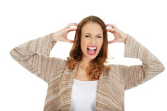 Angry woman screaming. Stock Photos