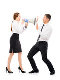Angry woman screaming on a businessman with a megaphone. Angry and irritated business women screaming on her employee. Feminism and emancipation concept stock images