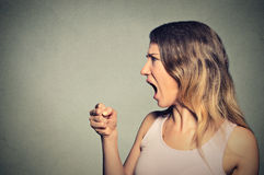 Angry woman screaming. With fist up in air Royalty Free Stock Photos