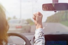 Angry woman screaming while driving a car. Angry woman screaming and gesturing while driving a car. Negative human emotions concept Royalty Free Stock Image