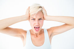 Angry woman screaming and holding her head. On white background Royalty Free Stock Photos