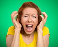 Angry woman screaming hysterical. Portrait angry woman screaming wide open mouth hysterical isolated green background. Negative human face expression emotion bad Royalty Free Stock Photography