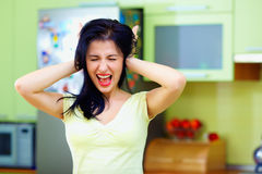 Angry woman screaming in kitchen, home interior Royalty Free Stock Image
