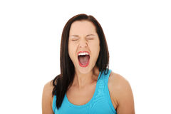 Angry woman screaming loud Stock Photo