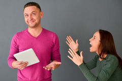 Angry woman screaming at man in a discussion. Angry women screaming at men in a discussion, standing Stock Images