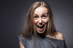 Angry woman screaming over dark grey Royalty Free Stock Photos