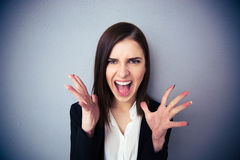 Angry woman screaming over gray background Royalty Free Stock Image