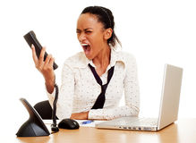 Angry woman screaming at the phole Royalty Free Stock Photography