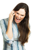 Angry woman screaming on the phone. An angry and very frustrated business woman yelling on the phone. Isolated over white Royalty Free Stock Image