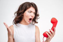 Angry woman screaming on phone tube. Isolated on a white background Royalty Free Stock Images