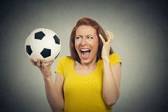 Angry woman screaming at soccer ball Royalty Free Stock Photography