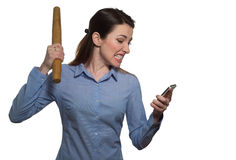 Angry woman screaming and threatens with rolling-pin holding a p Stock Photography