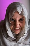Angry woman in shawl Stock Photography