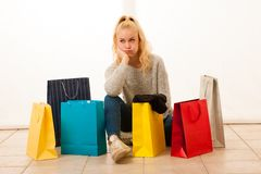 Angry woman with shopping bags after shopping as she spent all t. Angry woman with shopping bags after shopping as she spent all money Royalty Free Stock Photography