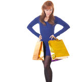 Angry woman with shopping bags over white Royalty Free Stock Photo