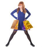 Angry woman with shopping bags over white Stock Image