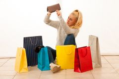 Angry woman with shopping bags after shopping as she spent all t Stock Image