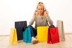 Angry woman with shopping bags after shopping as she spent all t. He money Royalty Free Stock Photo