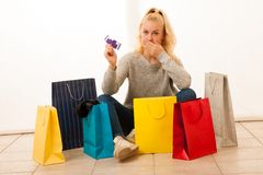 Angry woman with shopping bags after shopping as she spent all t. He money Stock Images