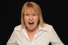 Angry woman shouting. An angry woman shouting at the top of her lungs royalty free stock images