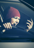 Angry woman shouting on cell phone in her car. Angry fashion woman shouting on cell phone in her car Royalty Free Stock Images