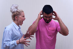 Angry woman shouting at her husband or boyfriend Stock Image