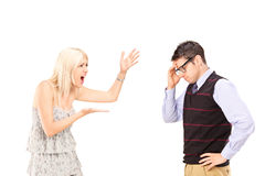 Angry woman shouting at a man. Angry women shouting at a man, isolated on white background Royalty Free Stock Photos
