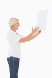 Angry woman shouting at piece of paper Stock Photos
