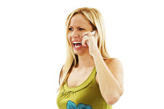 Angry woman shouts in phone Stock Image