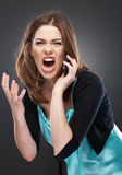 Angry woman shouts in phone Stock Photo