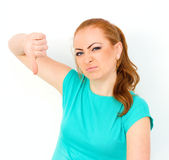 Angry woman showing her thumb down Royalty Free Stock Photos