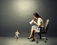 Angry woman and small calm woman Stock Photo