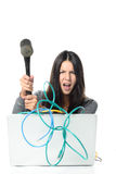 Angry Woman Smashing Laptop Using Hammer Stock Photography