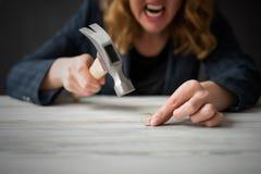 Angry woman smashing wedding ring Stock Photos