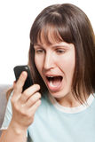 Angry woman talking mobile phone Royalty Free Stock Photography