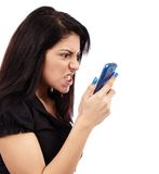 Angry woman talking on the phone Stock Image
