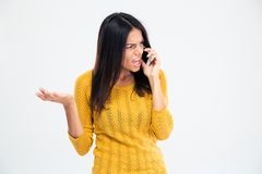 Angry woman talking on the phone Royalty Free Stock Photography