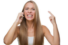 Angry woman talking on phone Royalty Free Stock Image
