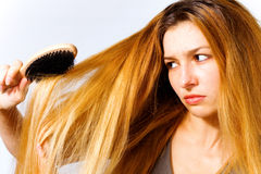 Angry woman with tangled hair problem Royalty Free Stock Photos