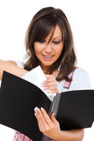 Angry woman tearing documents Stock Photo