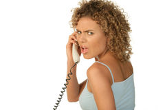 Angry woman on telephone. Isolated on white background Royalty Free Stock Photography