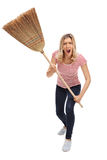 Angry woman threatening with a broom Royalty Free Stock Images