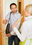 Angry woman threatens with rolling-pin Stock Image