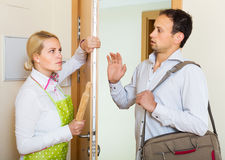 Angry woman threatens with rolling-pin Royalty Free Stock Photo