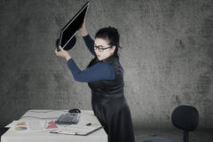 Angry woman throwing computer Royalty Free Stock Images